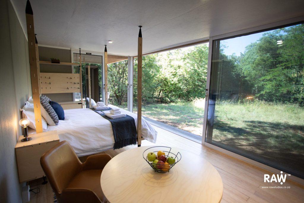 Zenkaya prefab living unit interior kitchen, dining, bed Stilts furniture